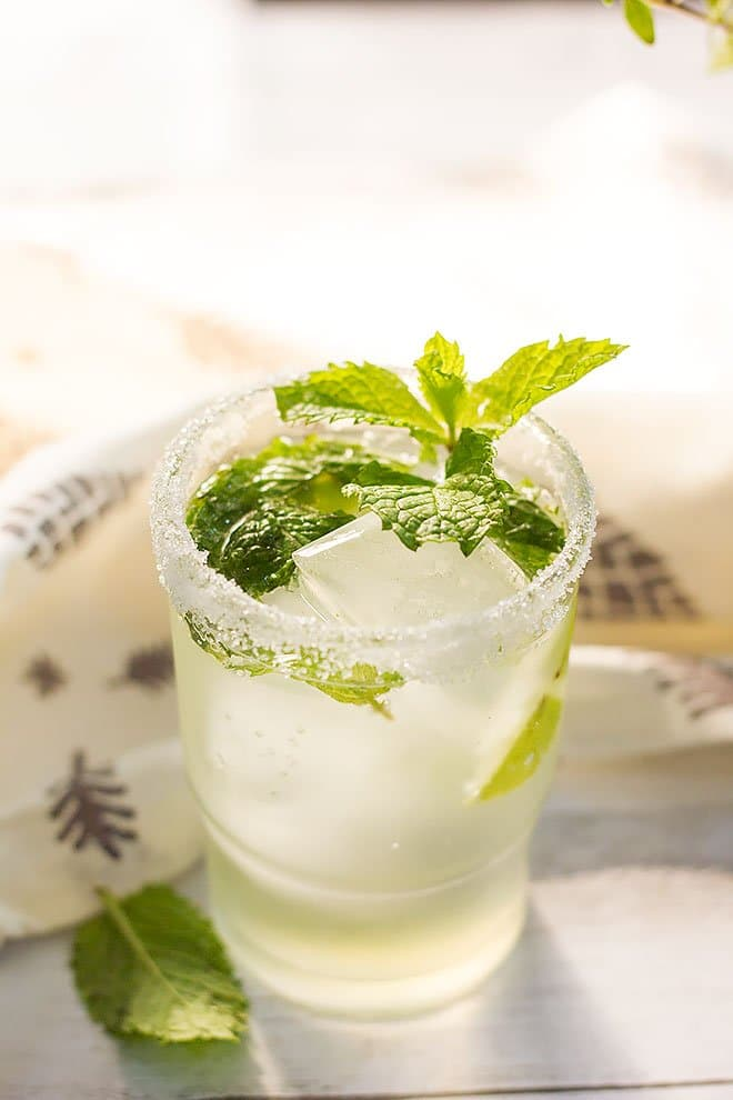Mojito served in a glass and garnished with mint.