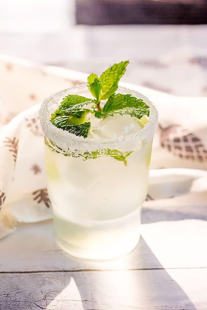 Mojito with fresh mint leaves in transparent glass.
