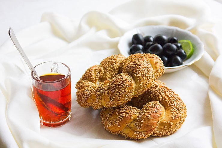 Turkish bread with red tea on the side.