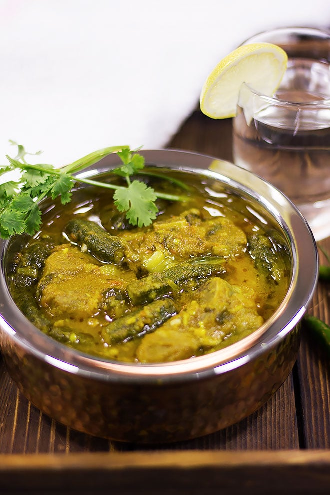 Authentic lamb bhindi masala served on brown table.