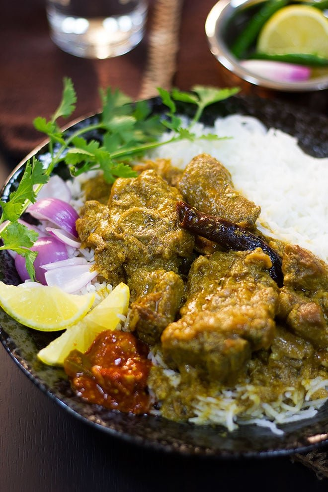 Mutton korma served with rice and achar.