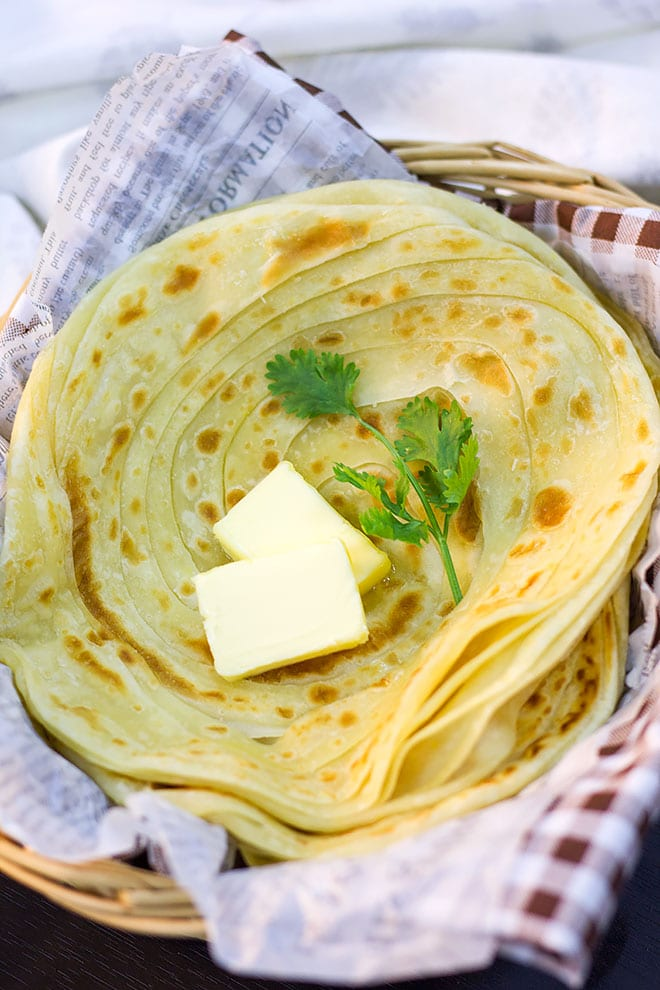 Stack of paratha in a basket.