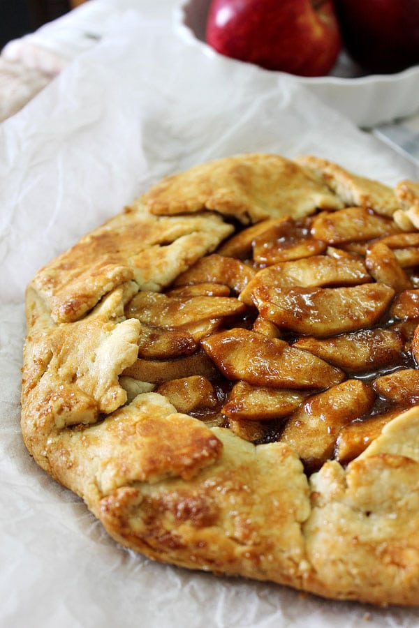 Close up image of Apple galette on parchment paper.