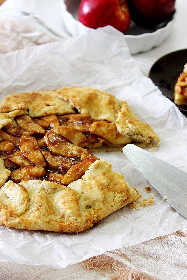 Side image of semi open apple pie.
