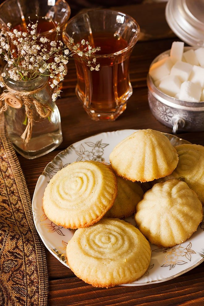 Maamoul Arabian cookies served with tea.
