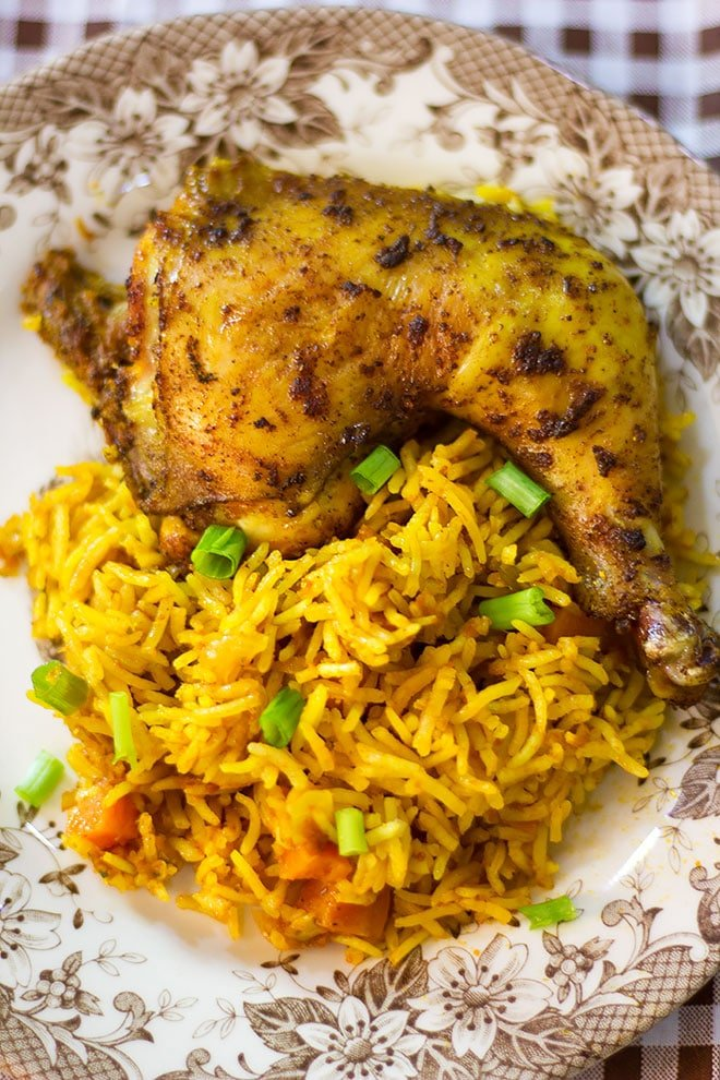 Jollof rice served with grilled chicken on the side.