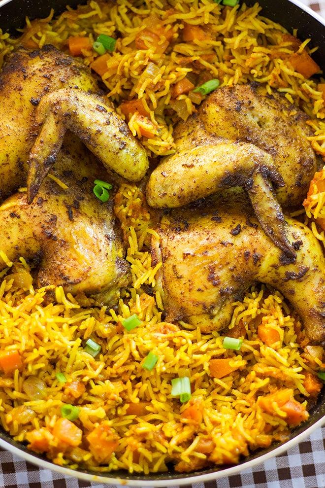 Nigerian Jollof rice topped with chicken.