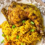 A small image of Jollof Rice with Grilled Chicken.