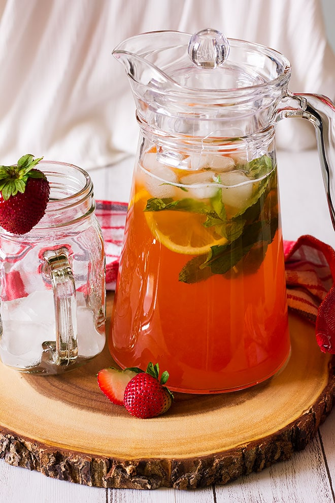 Fresh strawberry lemonade in a large pitcher.