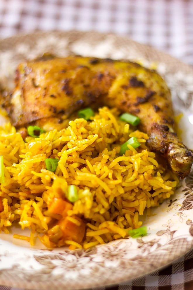 Fluffy and flavorful jollof rice served on a plate.