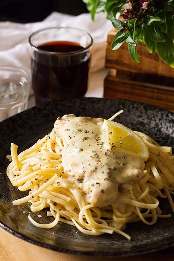 Creamy lemon chicken served on pasta.