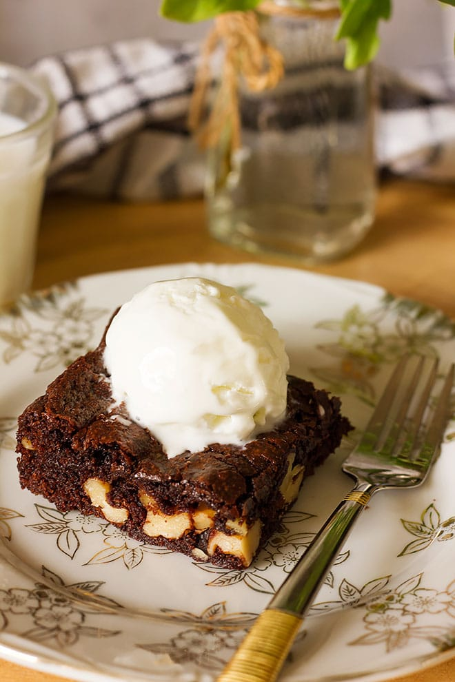 A serving of brownies topped with ice cream,