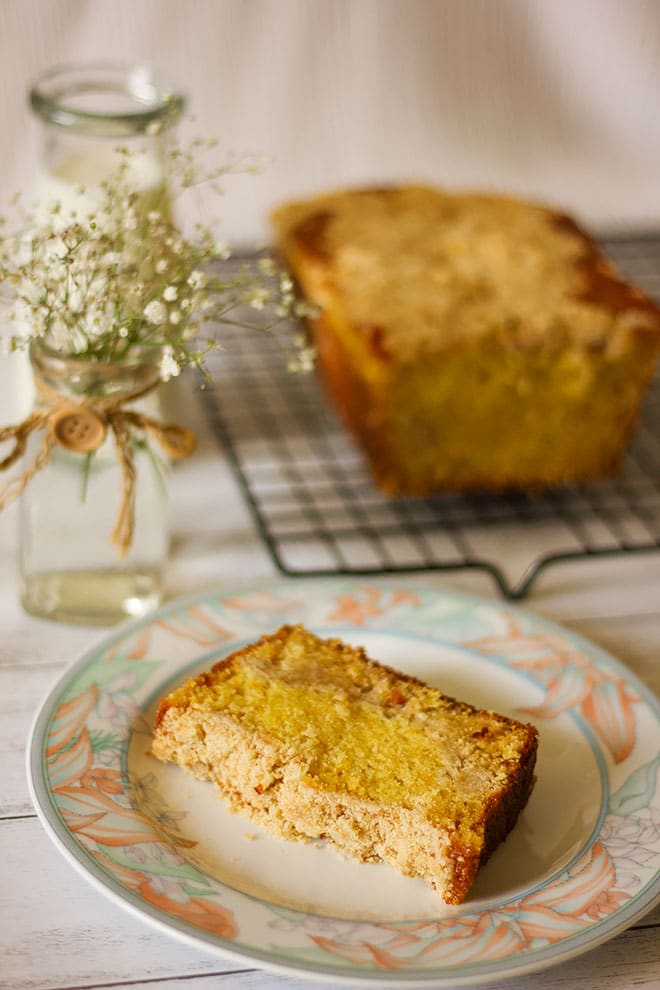 Orange cake with streusel served on a plate.