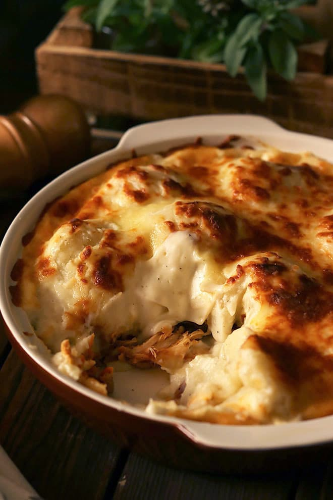 chicken and potato casserole with white sauce.