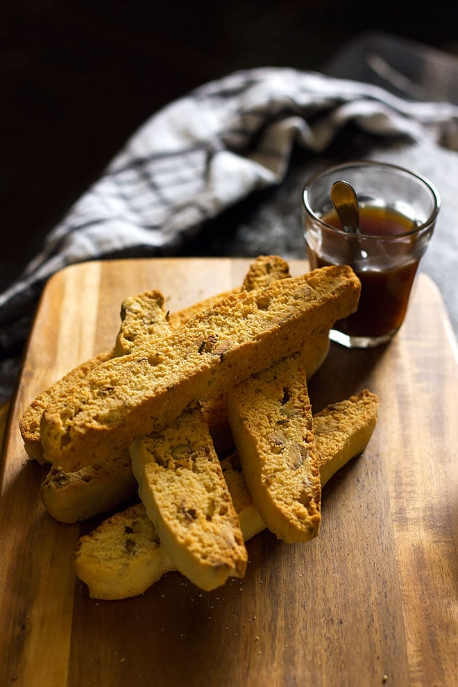 Stack of Italian Biscotti on a cutting board.