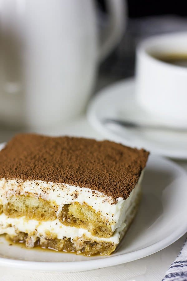 Egg free tiramisu served on white plate.
