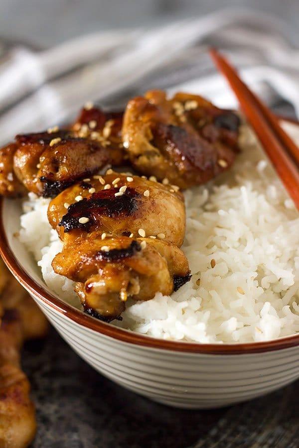 Juicy teriyaki chicken served on white rice.