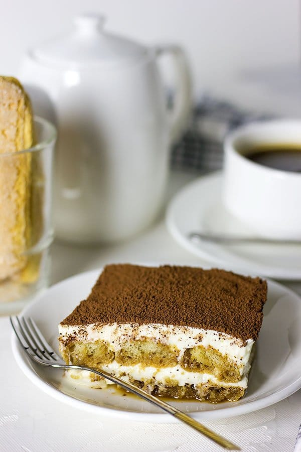 Close up image of eggless tiramisu on a plate.