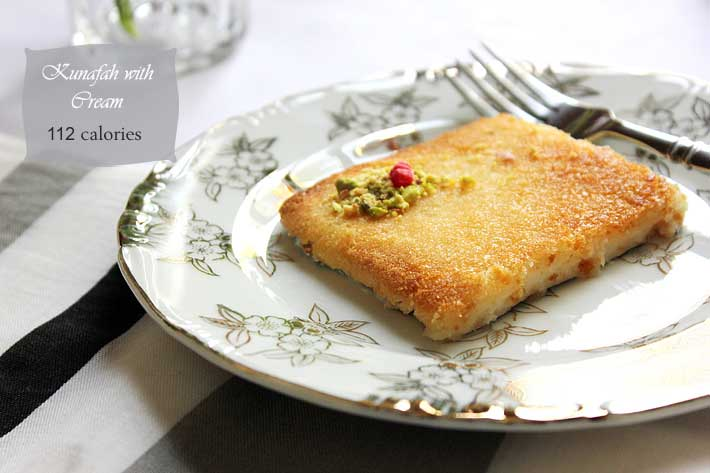 Freshly baked kunafa with cream.