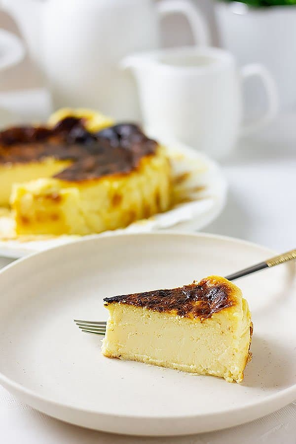 A slice of basque cheesecake showing creamy texture.