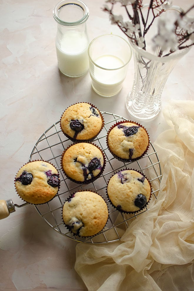 close up image showing blueberries in muffins.