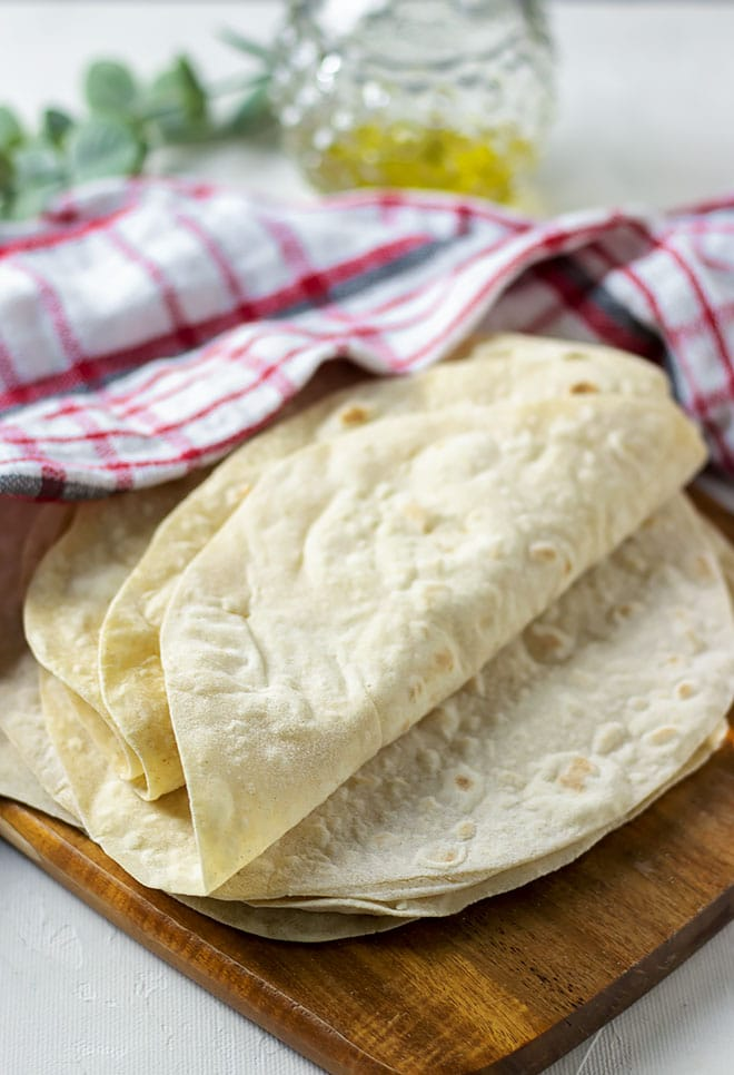 flour tortilla covered with towel.