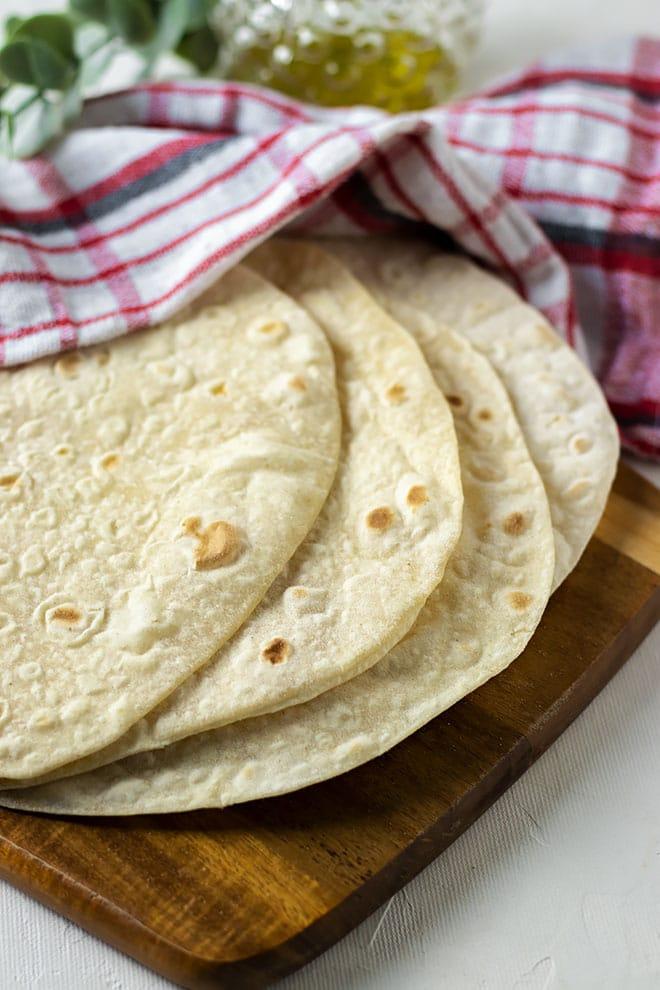 Soft tortilla on a cutting board.