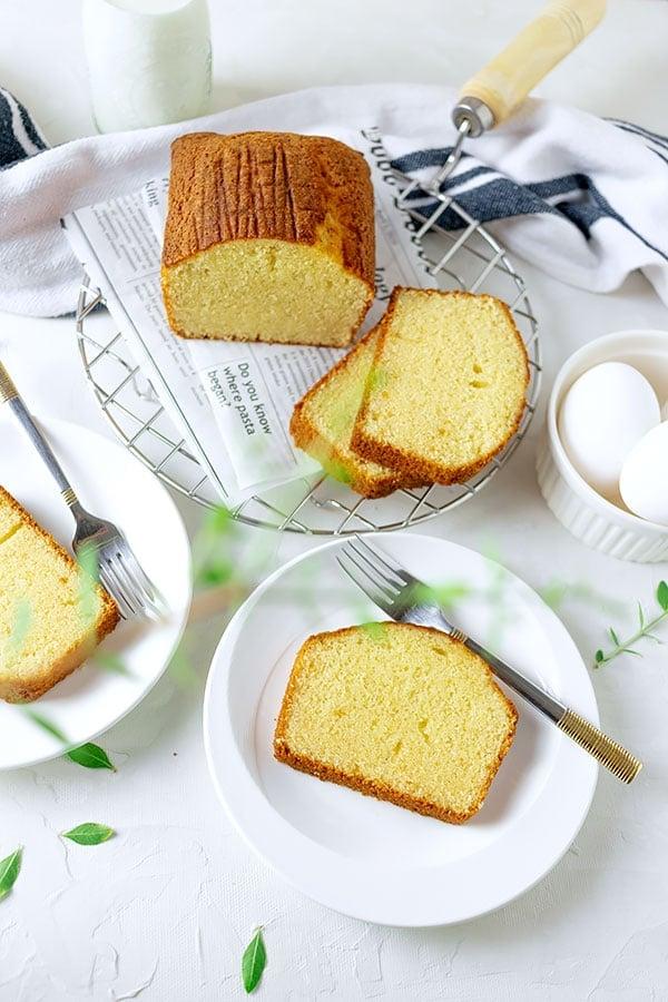 hot milk cake slice served on white plate.