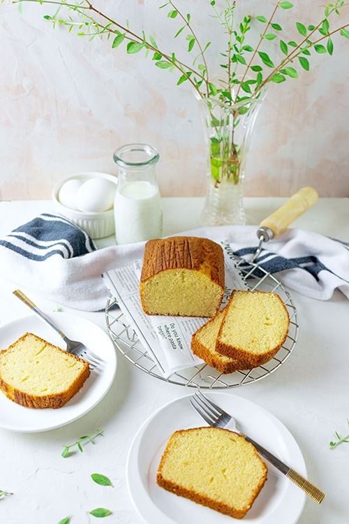 freshly baked milk cake placed on white table.