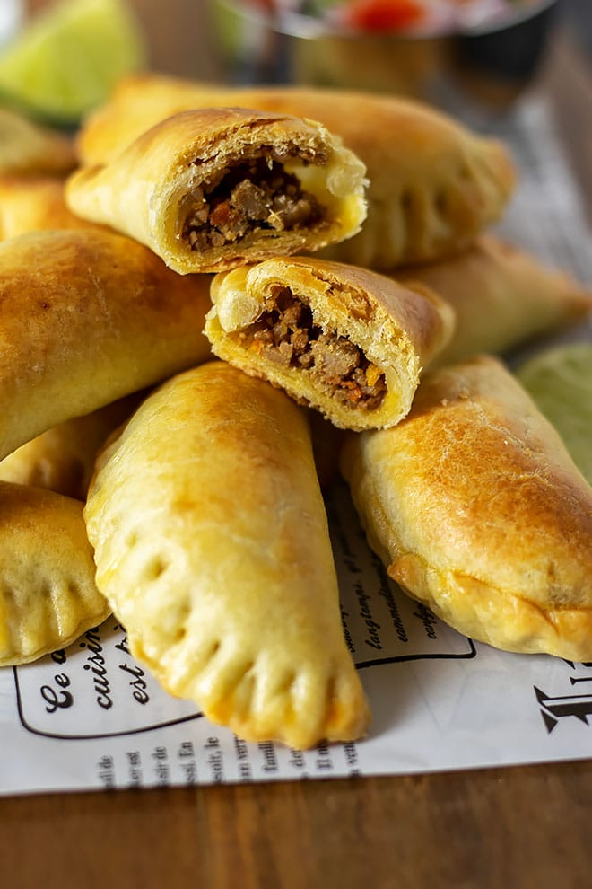 Close up image of empanadas filled with beef and vegetables.