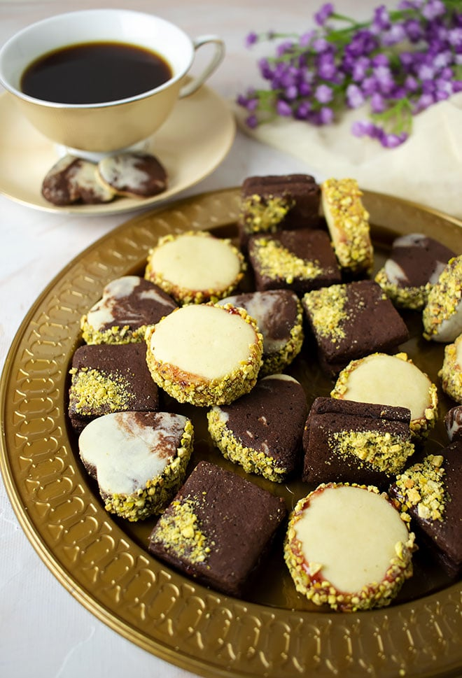 Elegant sugar cookies on a golden plate.