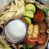 Small image of falafel with tahini sauce.